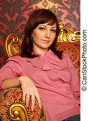 Portrait of girl sitting in armchair Interior in retro style...