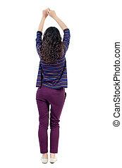 back view of dancing young beautiful woman. girl watching....