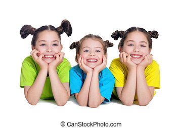 portrait of cute little girls posing in studio