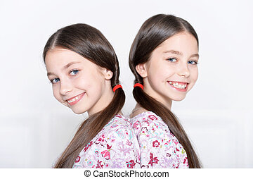cute little girls posing - portrait of cute little girls...