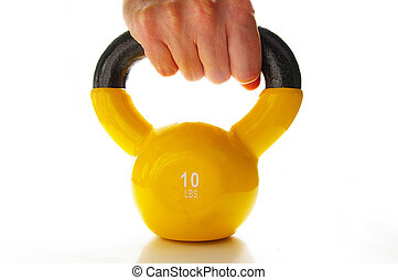 man grabbing a ten pound kettle-bell weight
