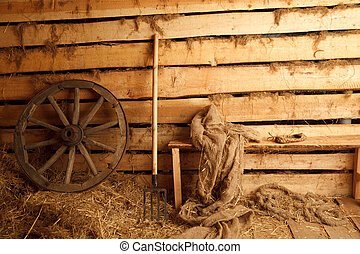 Interior of village building. Wheel, pitchfork, bench, cloth, bast shoe.