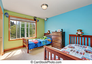 Blue and green kids bedroom with two beds.