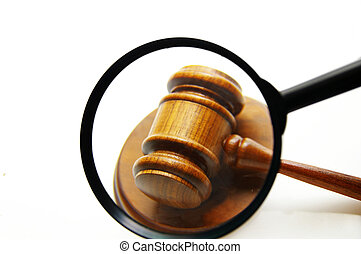 magnifying glass examining a judges court gavel (seek justice)