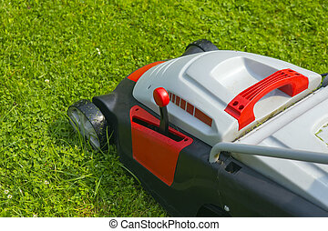 lawn-mower electric on green grass