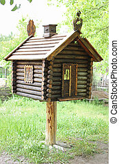 Toy house in the woods . A hut on chicken legs.