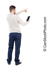 Back view of pointing young men talking on cell phone. Young...