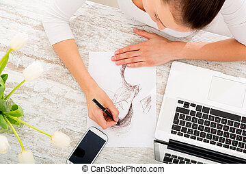 Young fashion Designer - A young fashion designer working...