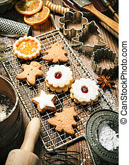 Christmas baking background with cookies, cookie cutters,...