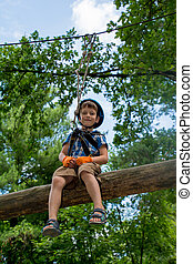 Five year boy on rope-way in park - Five year boy on...