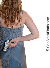 Closeup woman with gun behind back - isolated Closeup woman...