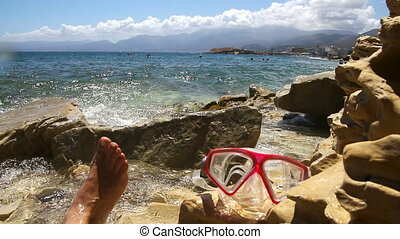 Carelessness on the shore near the crystal clear sea.Crete....