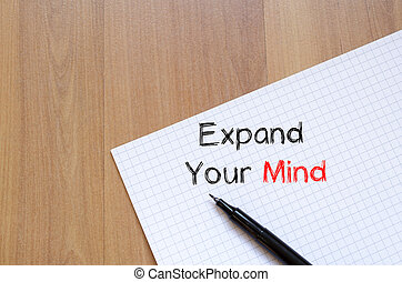 Expand your mind on notebook - Expand your mind text concept...