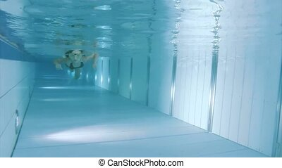 Underwater girl in aquapark - Child submerging under water....