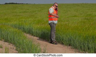 Farmer walking and talking on smart
