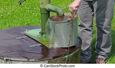 Man poured water from  bucket