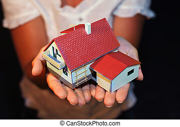 model of house with garage on hands
