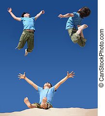 jumping boys on blue sky, sitting boy with hands and legs up...