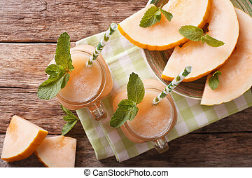 The juice of melon with mint in a glass jar. horizontal top view
