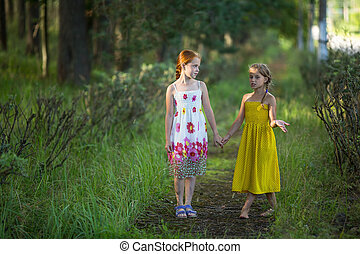 Two kids girls talking in the Park