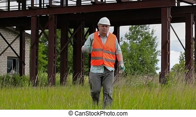 Angry worker with adjustable wrench walking and talking