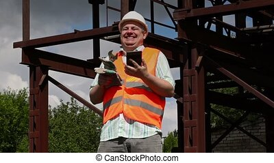 Worker watching tablet PC and laughs