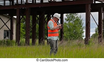 Worker walking and using tablet PC