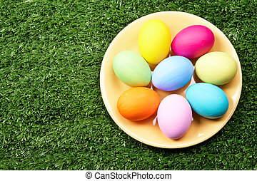 Easter composition - Image of several colored eggs placed on...