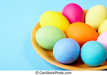 Tradition - Close-up of coloured traditional eggs lying on...