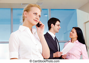 Calling female - Image of pretty employee speaking on the...