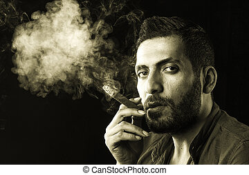 Man Smoking Cigar surrounded by Smoke / short bearded man...