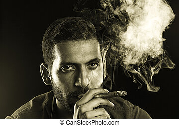 Man Smoking Cigar surrounded by Smoke short bearded man with...