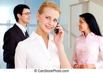 Telephone conversation - Image of pretty employee speaking...