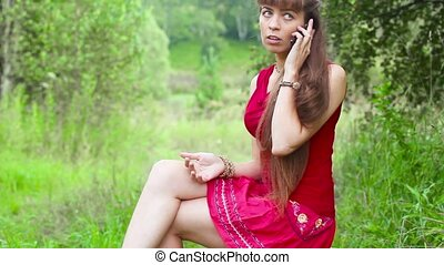 girl talking on the phone outdoors - Dialing and calling...