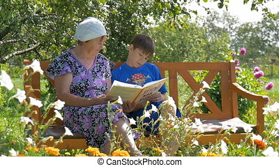 Grandson reading a book to his grandmother.