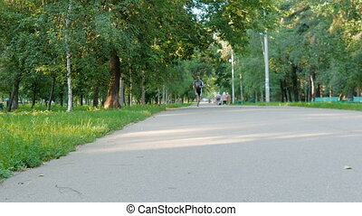 The man likes to run in the park, for a healthy lifestyle