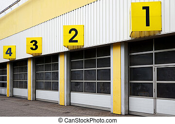 industrial building with numbered gates - industrial...