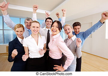 Victory - Portrait of successful people raising hands...