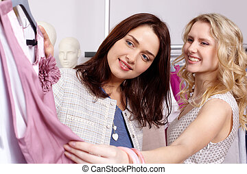 Shopaholics in clothing department - Image of pretty friends...