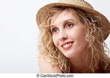 Female in hat - Portrait of young blond female wearing straw...