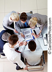 People at work - Above view of business partners shsaring...