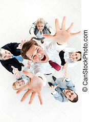 Joyful businessman - Above view of several successful...