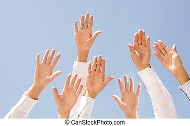 Support - Image of several human palms raised against clear...