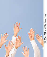 Voting - Image of several human palms raised against clear...