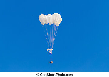 Military cargo parachute flying in the sky.