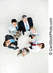 Business group - Above view of several business partners...