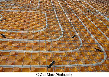 Underfloor heating - Orange posed Underfloor heating tube in...