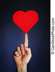 Easy Love - Man holding a glowing red heart on his fingertip