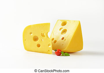 wedges of yellow cheese with eyes - two wedges of Swiss...