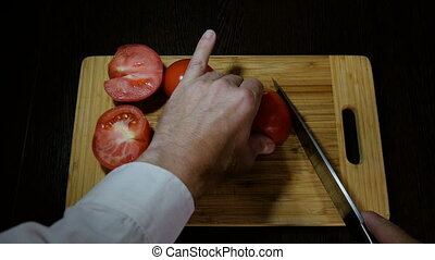 Chef cuts red tomatoes for salad HD